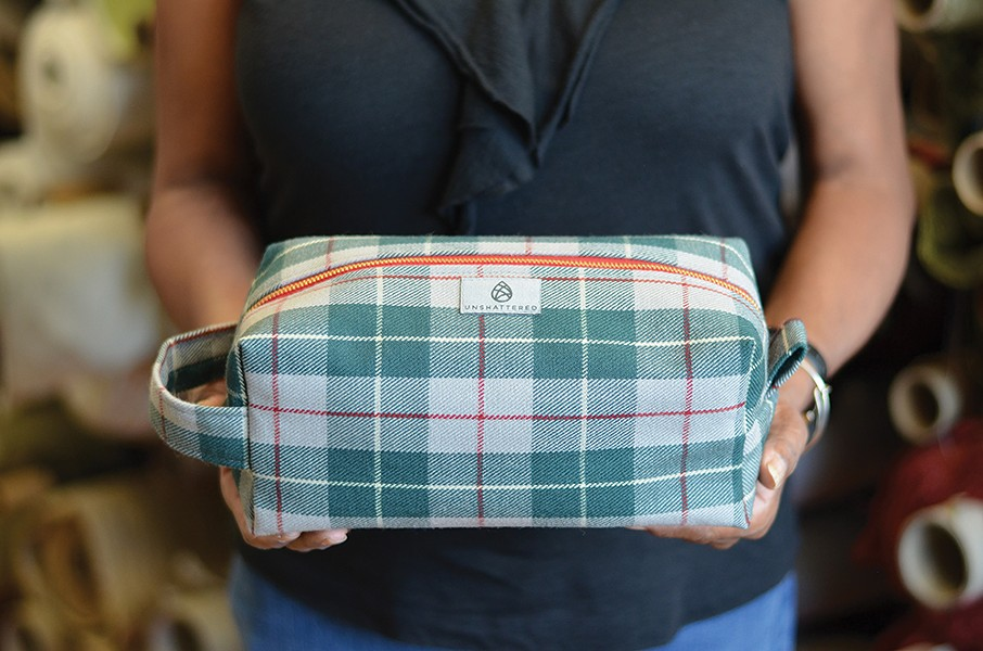 A toiletry kit made from 1955 Mercedes Benz upholstery.