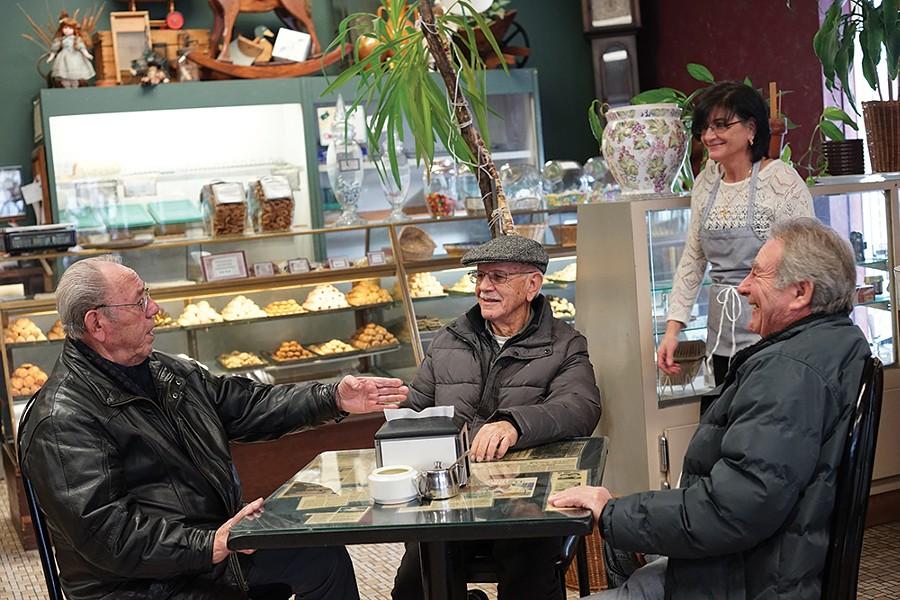 Albino Curcio, Carmelo Petula, Emily Paonessa, and Angelo Incoruaia at Caffe Aurora. - PHOTO BY JOHN GARAY