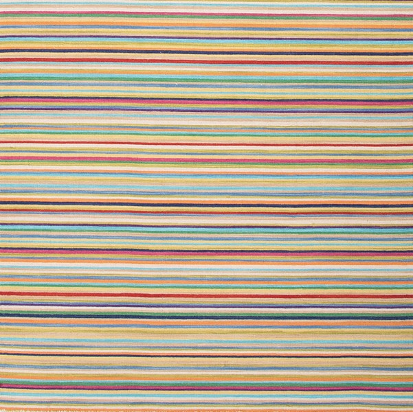 A reversible handmade flat-weave wool rug in cheerful and colorful thin stripes from Burkleman in Cold Spring