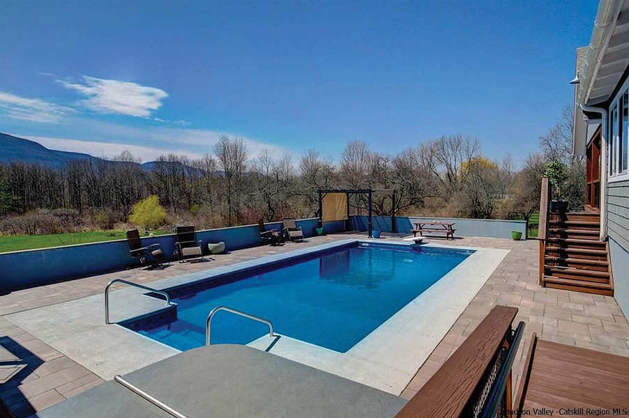 The backyard features a heated saltwater pool