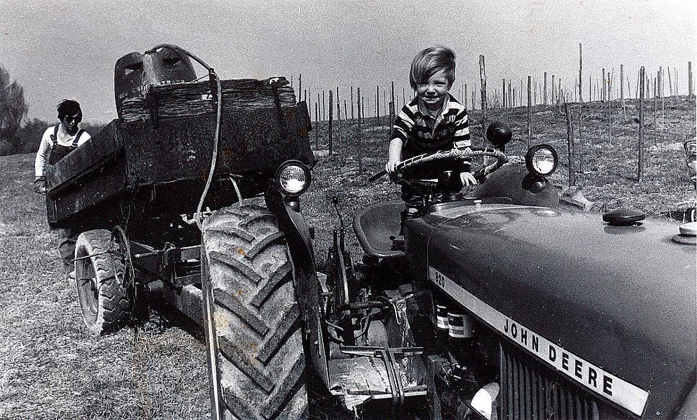 Yancey and Michael's son Tristan, helping around the farm at an early age. Tristan now manages the Wine Club and Whitecliff's wholesale accounts.