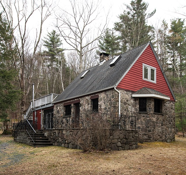 The handbuilt home was once part of an enclave of Norwegian immigrants and retains many of the original architectural details of rich wood, iron trim, and bluestone. Stewart covered the back porch and added screens. - PHOTO: DEBORAH DEGRAFFENREID