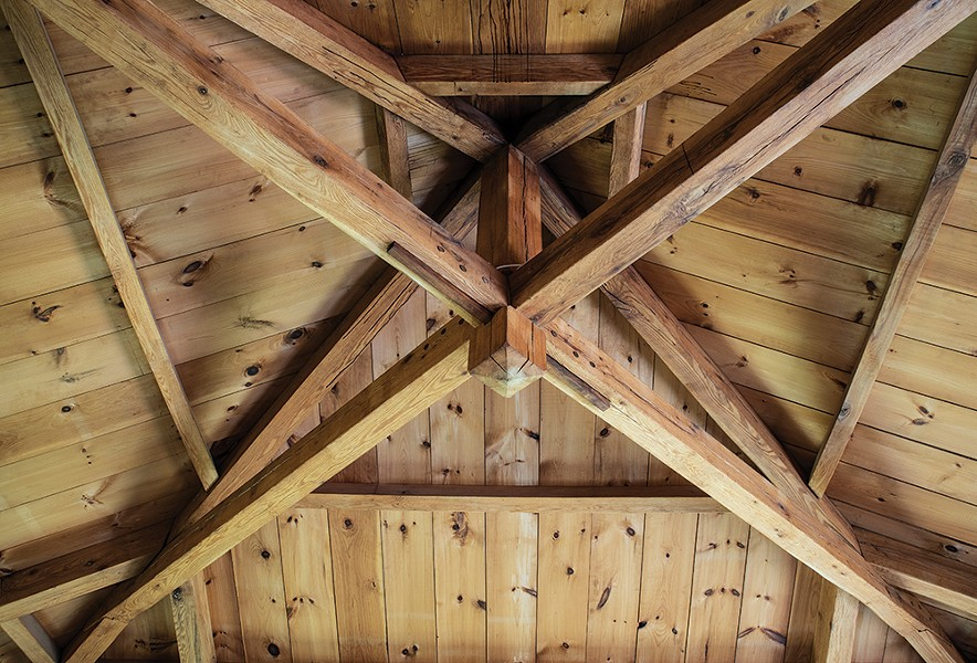 The home's main room has a vaulted ceiling and a cupola. After clearing the land, Duncan milled the beams himself from the property's abundant red oaks and used mortise-and-tenon joinery to frame the house. - PHOTO: DEBORAH DEGRAFFENREID