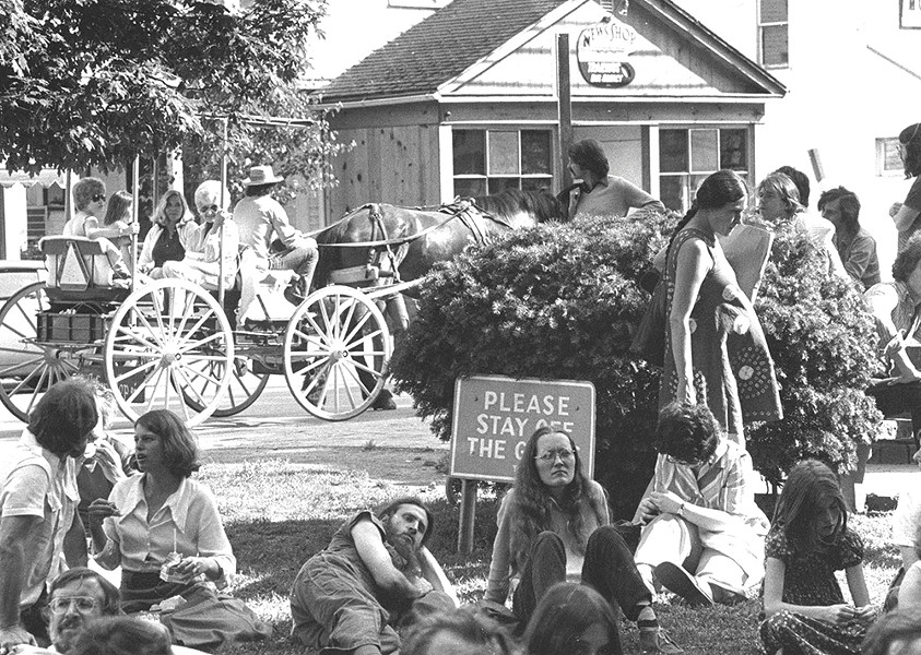 People relaxing on the Village Green. - COURTESY OF THE HISTORICAL SOCIETY OF WOODSTOCK