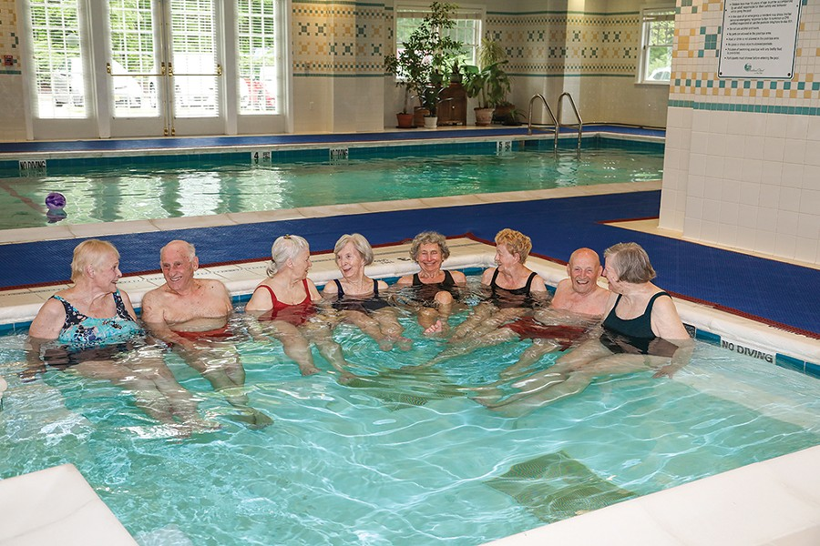Residents enjoy a dip in the onsite pool.