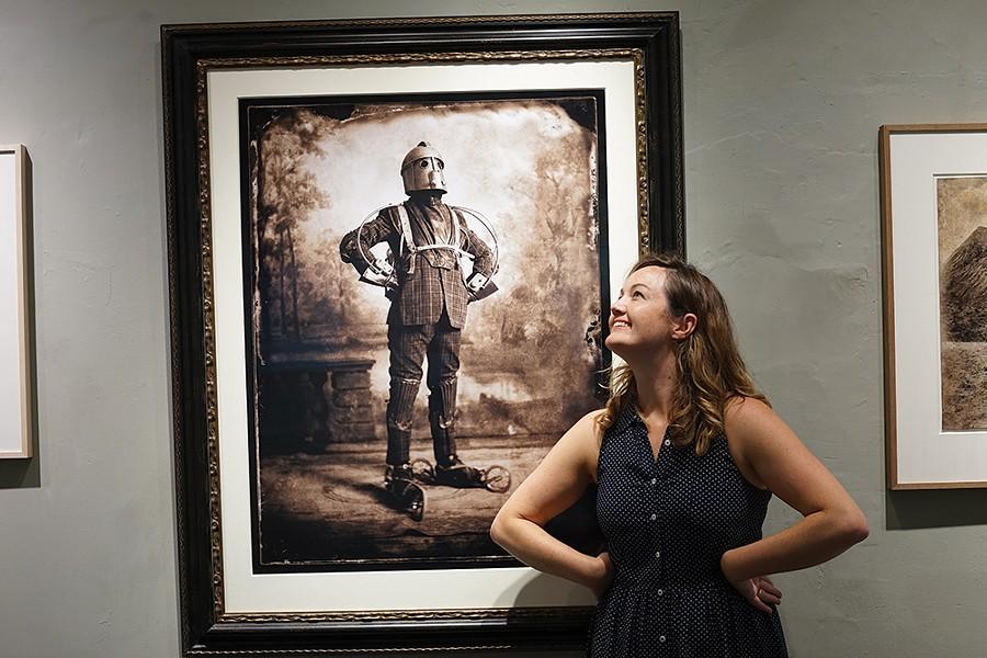 Linden Scheff mimicks Nick Simpson's The Perambulator at Carrie Haddad Gallery. - PHOTO: JOHN GARAY