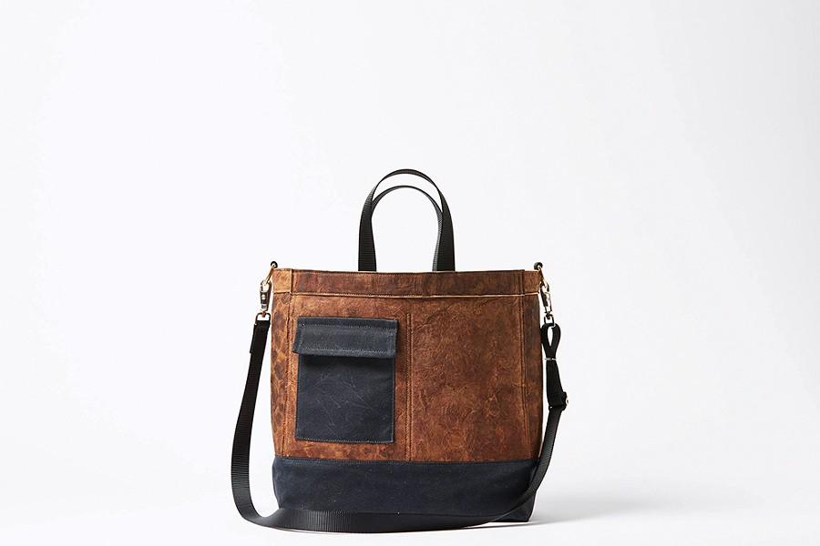 The Mylo Driver Bag uses mycelium leather.