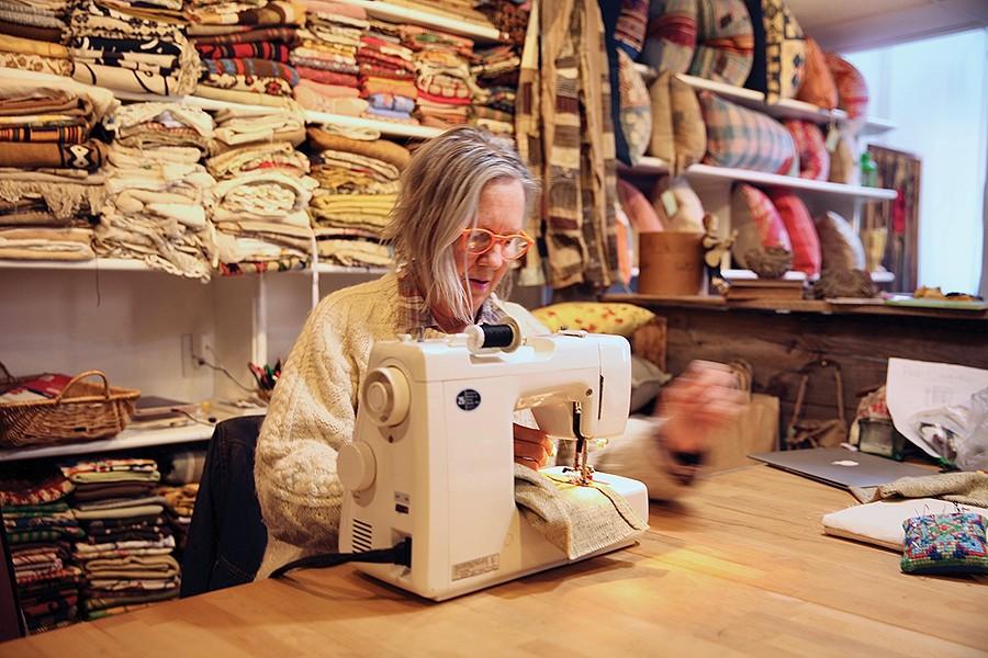 Chrisie Cordrey sews in her studio/retail store Corduroy Shop. - PHOTO: NIVA DORELL