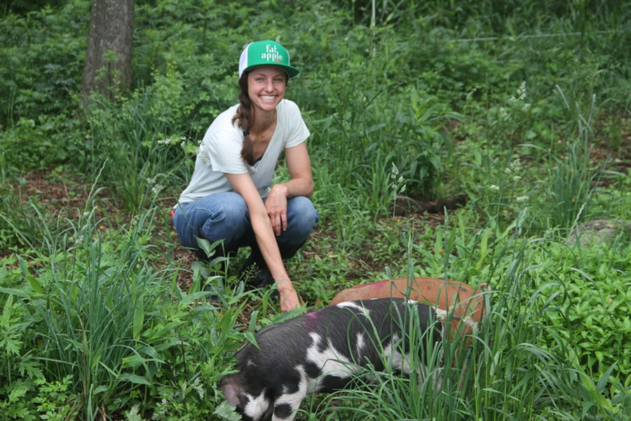 Second-Year Livestock Apprentice Emily Lupico tends to Glynwood's pigs.