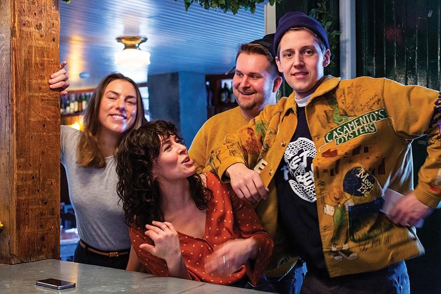 Prairie Whale staffers Sarah Kate Hartt, Alex Pendergist, and Taylor Nickel with patron Nick Bloomstein. - PHOTO: ANNA SIROTA