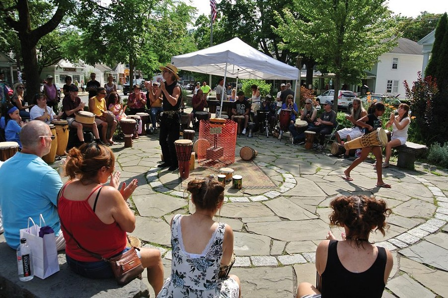 A drum circle on the Woodstock Green. - JOHN GARAY