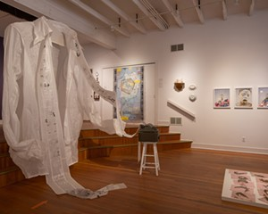 """Left to right: """"Words Untie Knots, (Pussy Bow Blouse Redux),"""" Kate Hamilton, 2016/2021. """"Letter to the World,"""" Yura Adams, 2021. Late 18th-early 19th century staple repaired porcelain. """"Bodies of Plenty: Harvest, Spoils, Sprout and Root,"""" Corinne Spencer, 2013. """"Tiaras,"""" Katherine Umsted, 2013."""