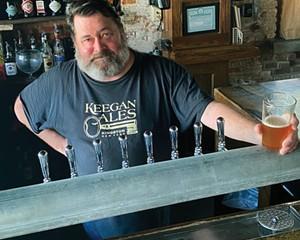 Tommy Keegan behind the bar at Keegan Ales.