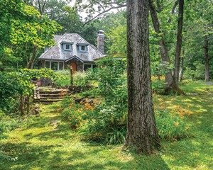 Linda Facci and Gene Gironda's home sits on three acres of gardens, winding bluestone paths, and stone terraces. The property sits in the heart of the former Maverick Art Colony, site of the early 20th-century music and art festivals held every summer.