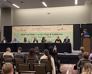 David Holland (right) leading panel discussion during the Cannabis Education Forum.