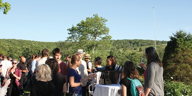 Chronogram Conversations Glynwood Center Angry Orchard pours cider samples to eager event attendees.
