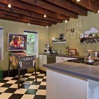 Home Is Where the Art Is The kitchen features a 1978 Bally Playboy pinball machine. Deborah DeGraffenreid