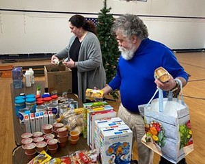 Volunteers unbox groceries at San Miguel Academy's COVID-19 pantry