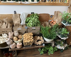 Village Coffee and Goods has expanded their grocery section, including a spread of fresh produce.