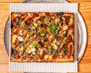 The El Camino features caramelized pineapple, roasted poblano, slow-roasted pork shoulder, Stubbs BBQ sauce, parmesan.
