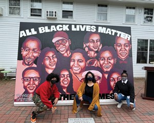 Brandon Christiansen, Mary Haddad, and Jenine Tobias in front of the BLM mural they helped create