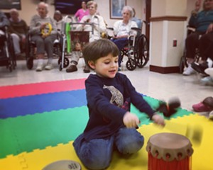 4-year-old Iggy enjoys Music Together with young and old classmates at the Thompson House