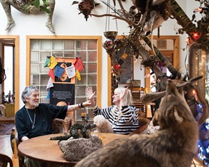 Ty Castellarian and Diane Termana sit at the center of their art-filled home. The ceramic Buddha once belonged to actor Lee Marvin.