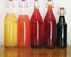 Taste the rainbow. Meads from left to right: peach, rose-rhubarb, grape, black currant, elderberry-yarrow.