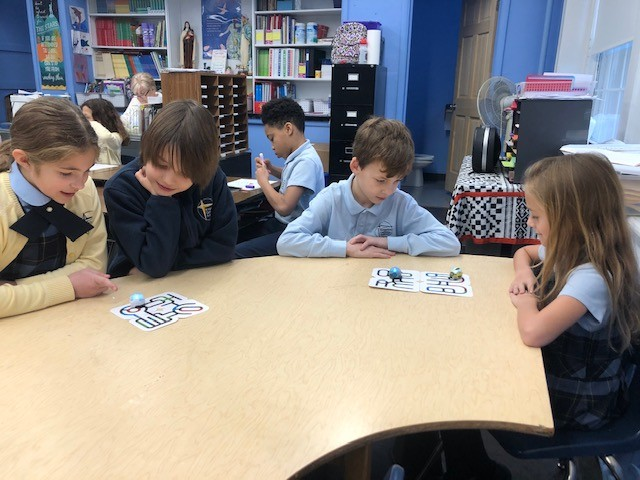Third-graders at Kingston Catholic School using Ozobots to learn basic coding.