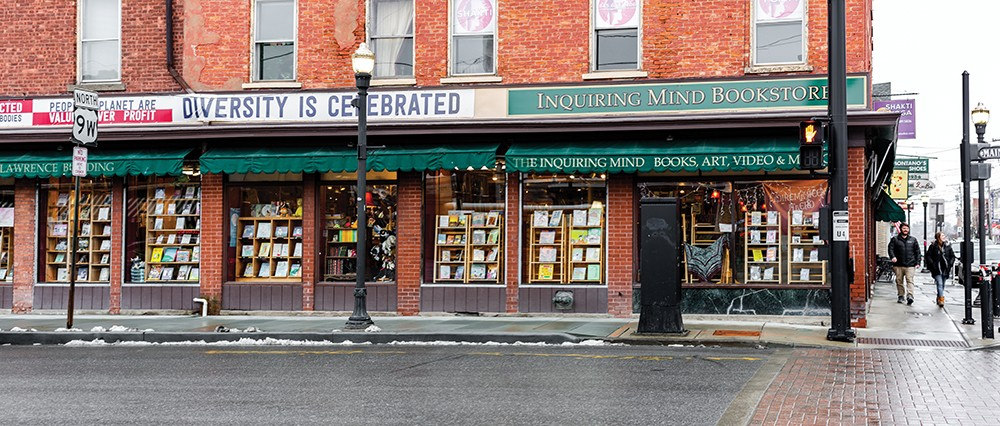 Inquiring Minds Bookstore is an independent bookshop with locations in Saugerties and New Paltz that's not afraid to wear its politics on its storefront. - PHOTO BY ANNA SIROTA