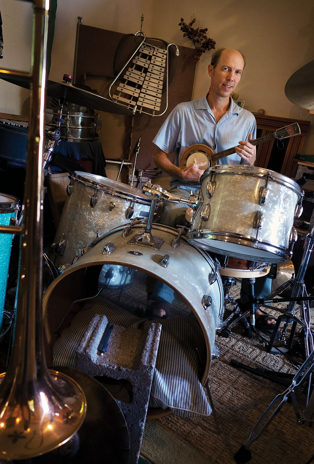 Dean Jones in his No Parking Studio. Citing a lack of minority nominees in their category, the Rosendale children's musician and his band, Dog on Fleas, asked the Recording Academy to remove them from the list of the 2020 Grammy nominees. - PHOTO BY FIONN REILLY