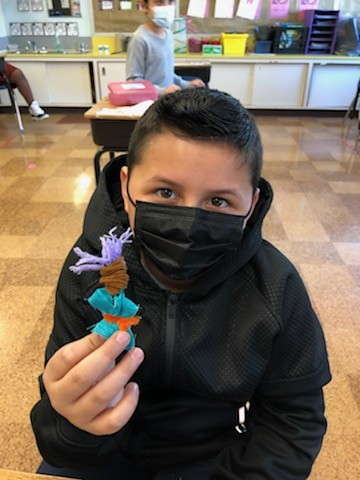Kingston student with worry doll. - REHER CENTER