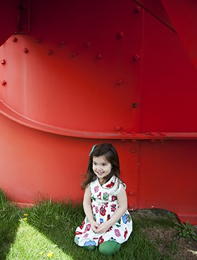 "A 3-year-old enjoys the shade of ""Gui (Mistletoe)"" an Alexander Calder sculpture from 1976 at the Storm King Art Center - HILLARY HARVEY"