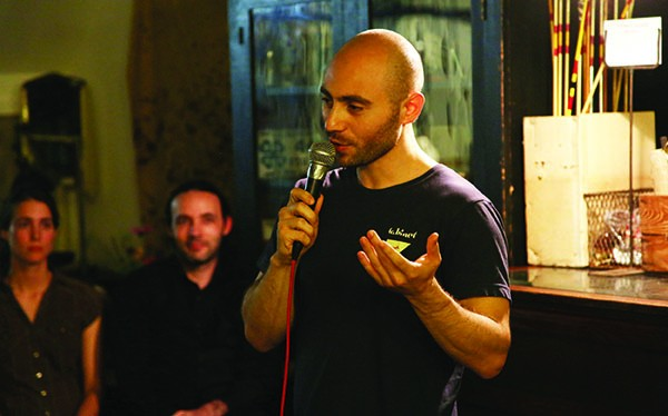 Andrew Steiner performing stand-up at Outdated Café in September.