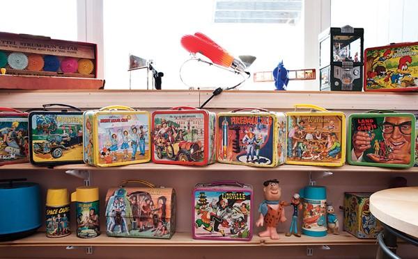 Basile's collection of 1960s metal lunch boxes. - DEBORAH DEGRAFFENREID