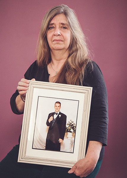 Audrey Degondea with a photo of her 20-year-old son Ean, who overdosed on heroin in June 2008. - RACHEL BRENNECKE