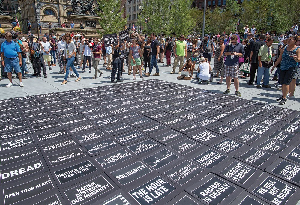 Anti-Trump Democrats encouraged bystanders to pick up message placards and to carry them  throughout the park and into surrounding streets. Many of the messages were biblical in tone. - FRANK SPINELLI