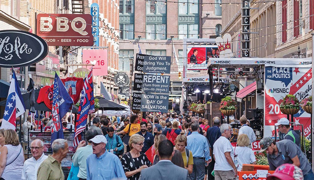 Live broadcast of the Convention attracted hundreds of people. Many stood in the camera view hoping to be seen waving their messages on natural television. Tom Brokaw, Andrew Mitchel, Tamron Hall, and Chuck Todd were among the many anchors broadcasting live on the street. - FRANK SPINELLI
