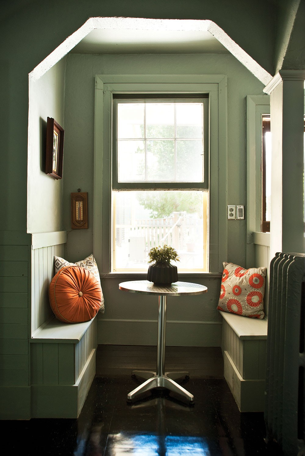 """The home's breakfast nook. """"I've gone through so many cans of paint in this house,"""" Sexton says. """"I painted one color, lived with it for a while, then painted it again. It's a creative process."""" - DEBORAH DEGRAFFENREID"""