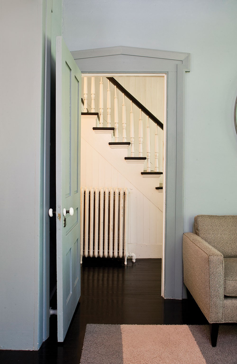 """The couple has restored the home's original staricase. """"We had to custom mill the spindles and custom build the new bannister,"""" Sexton says. - DEBORAH DEGRAFFENREID"""