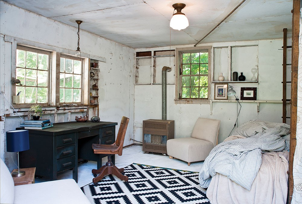 """""""By the time we got to rennovating this space, I was done painting for the year, so we just left it alone,"""" Sexton says. The ladder-like former wood beam holders now frame an extra bed. """"I spend a lot of time out here in summer and even sleep here when it's hot."""" - DEBORAH DEGRAFFENREID"""