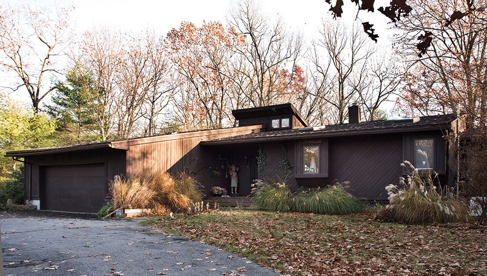 The front enterance of Termana and Castellarian's contemporary home in the Woodstock halmet of Zena, which was designed to arise from, and blend in with, the surrounding woods. - DEBORAH DEGRAFFENREID