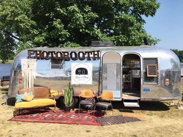 A photobooth in an Airstream at a wedding by Rose & Dale. Photo by Nina Young