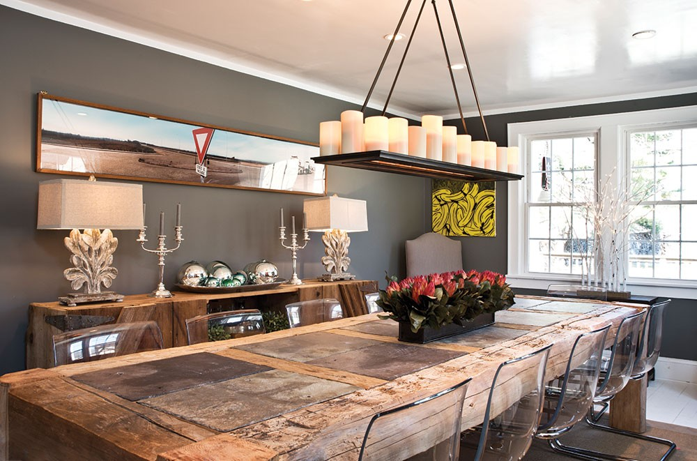 The Adams' dining room. Daniel Adams designed the family's wooden dining room table to include slate plate settings. Chalk is always on hand to mark seating arrangements or entertain children. - DEBORAH DEGRAFFENREID