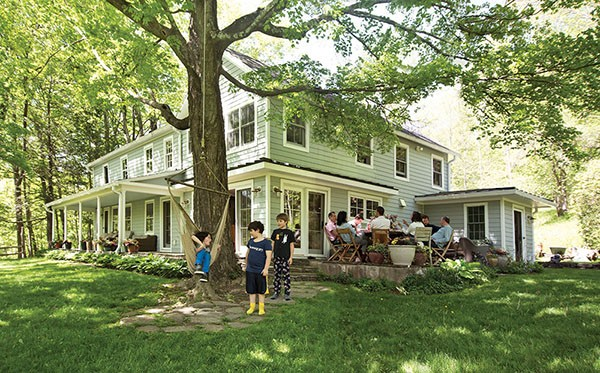 """The 1775 Colonial is surrounded by a grove of mature oaks and giant sugar maples. """"It's wild to think the house is older than the trees,"""" says Leonard. """"We finally tapped the sugar maples for the first time this past spring."""" - DEBORAH DEGRAFFENREID"""