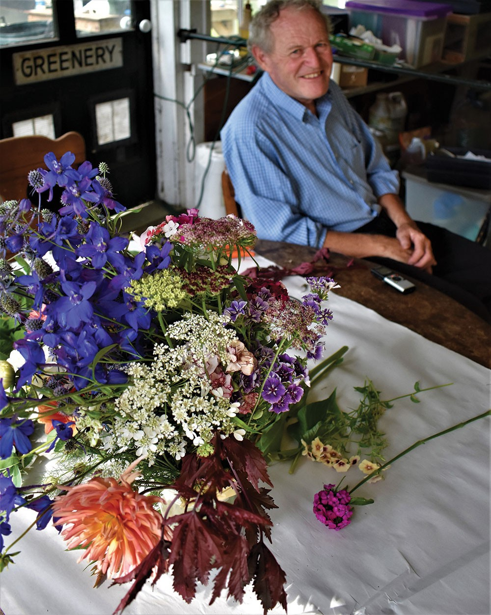 0afad67f99e27 click to enlarge Tim Steinhoff with some of his favorite cut flowers. -  LARRY DECKER
