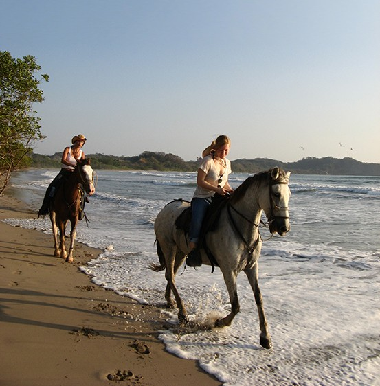 Horse back riders in Costa Rica - OMEGA INSTITUTE