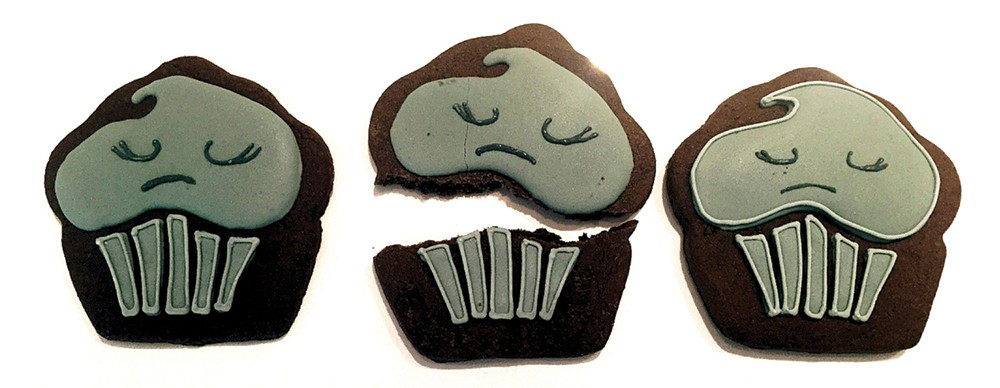 Cookie from the Depressed Cake Shop, a grassroots organization that hosts specialized - pop-up bake sales worldwide to get people - talking about mental health.