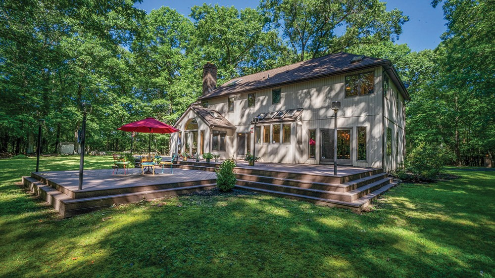 On the market for the first time since its construction in 1988, this spacious and tranquil custom-built contemporary rests on 54 private, wooded, subdividable acres a half mile from Main Street in Rosendale. The nearly 3,000-square-foot rural retreat features an openfloor plan with hardwood and marble; expansive eat-in kitchen with an island and custom built-in refrigerator; three large bedrooms with walk-in closets and skylights; a massive basement with high ceilings and Bdry system; and an oversized attached two-car garage with storage loft. A rare find in a historic Ulster County hamlet, this home is priced to sell at less than $850,000.