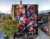 """""""Pronskstilleven,"""" is a 2015 mural by Gaia, on the RUPCO building in Uptown Kingston"""